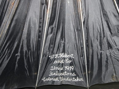 Embroidered section of undertaker's umbrella from Hebert & Company. (Gift of Sharon Gillins )