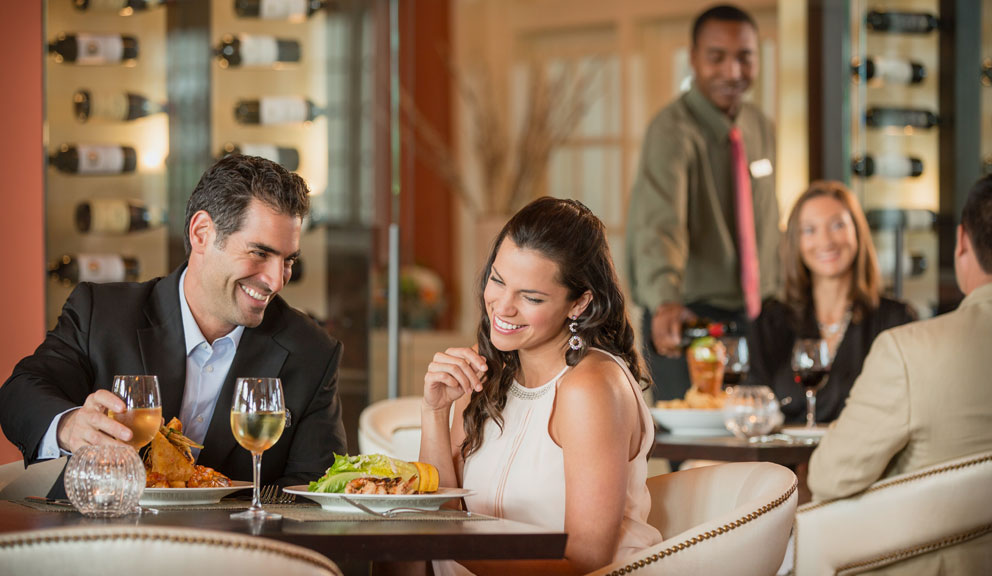 Couple Dining at Galvez Bar and Grill, Photo by Terry Vine and courtesy of Hotel Galvez & Spa, Galveston, TX