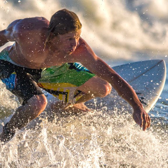 Young Male Surfing in the Gulf, Galveston TX