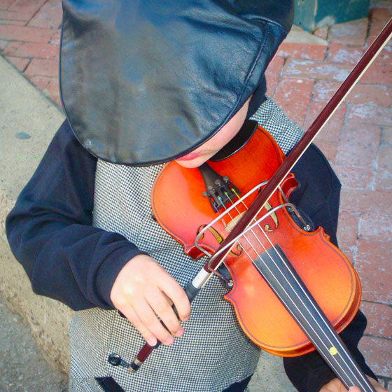 Young Boy Playing the Violin at Dickens on The Strand