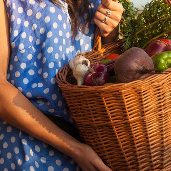 Photo of Female Holding a Basket of Fresh Produce