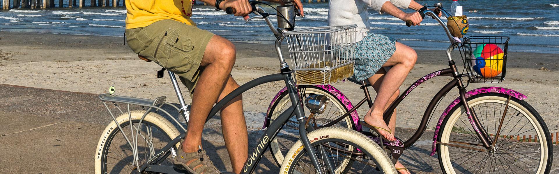 Couple Biking Along Seawall Boulevard, Galveston TX