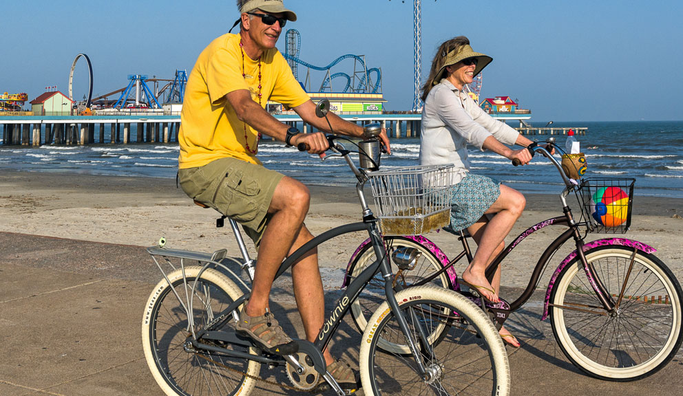 Couple Biking Along Seawall Boulevard, Galveston