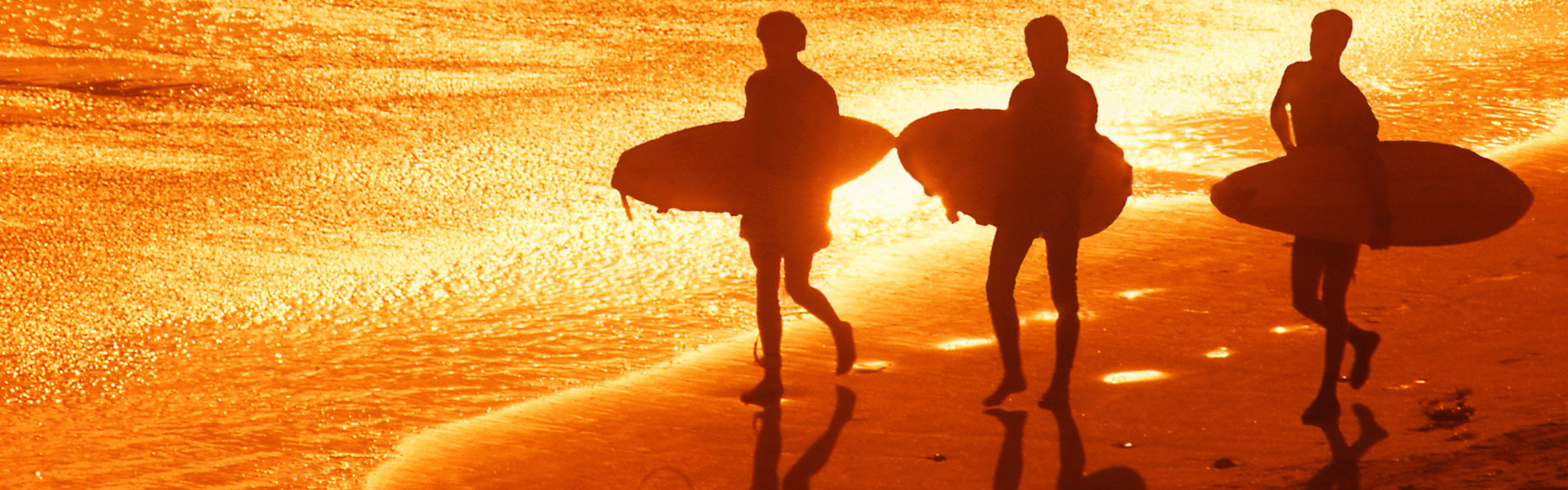 Surfers on the Beach at Sunset, Galveston, TX