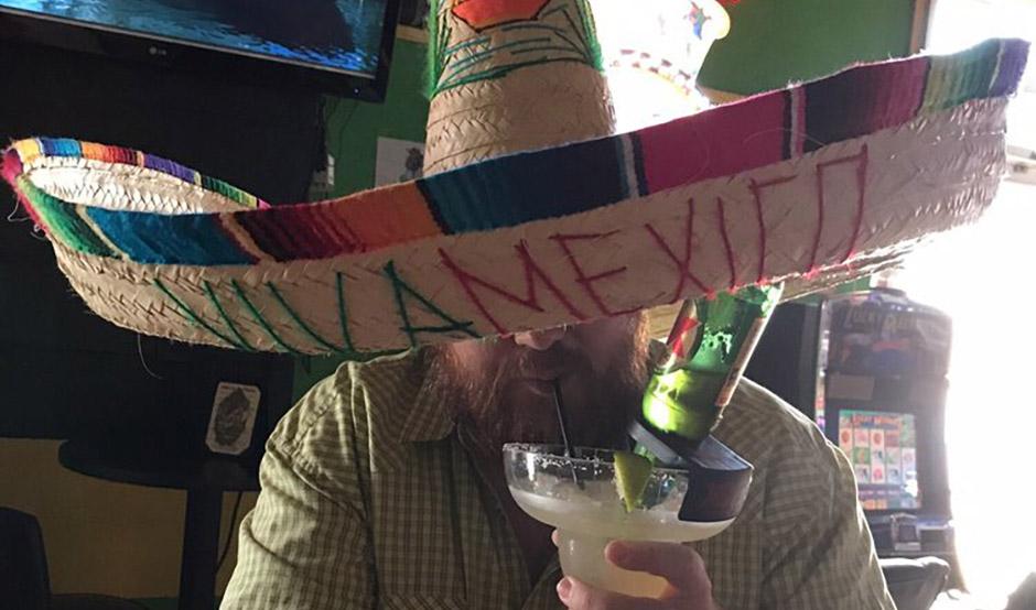 Guy Drinking Margarita at Lucky Lounge