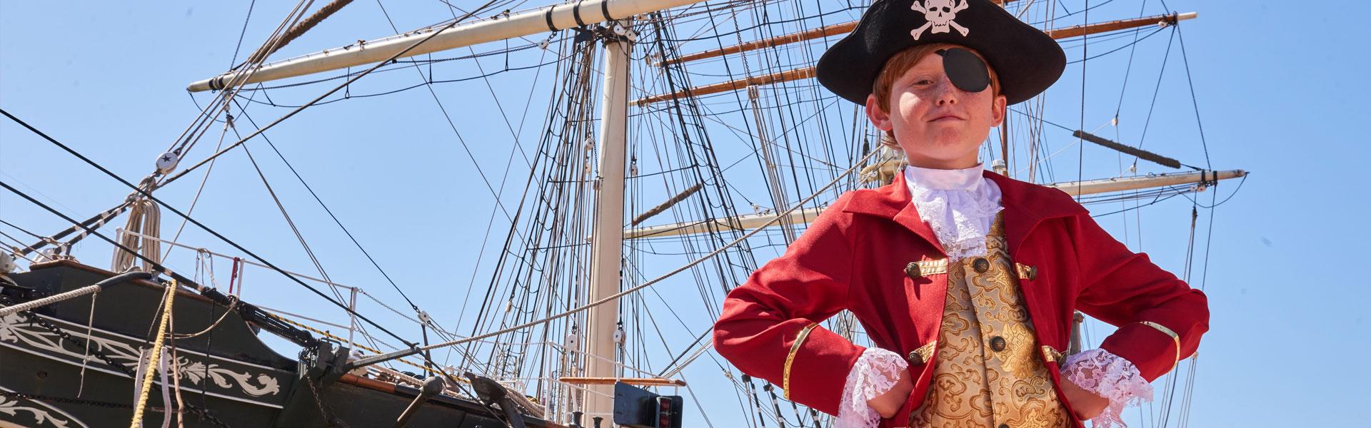 Boy Standing in Front of Tall Ship ELISSA, Galveston, TX