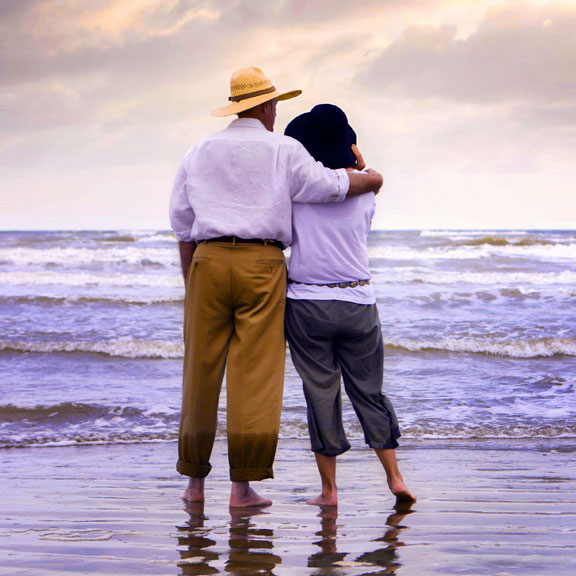 Couple at the Beach Looking Toward the Gulf of Mexico, Galveston, TX