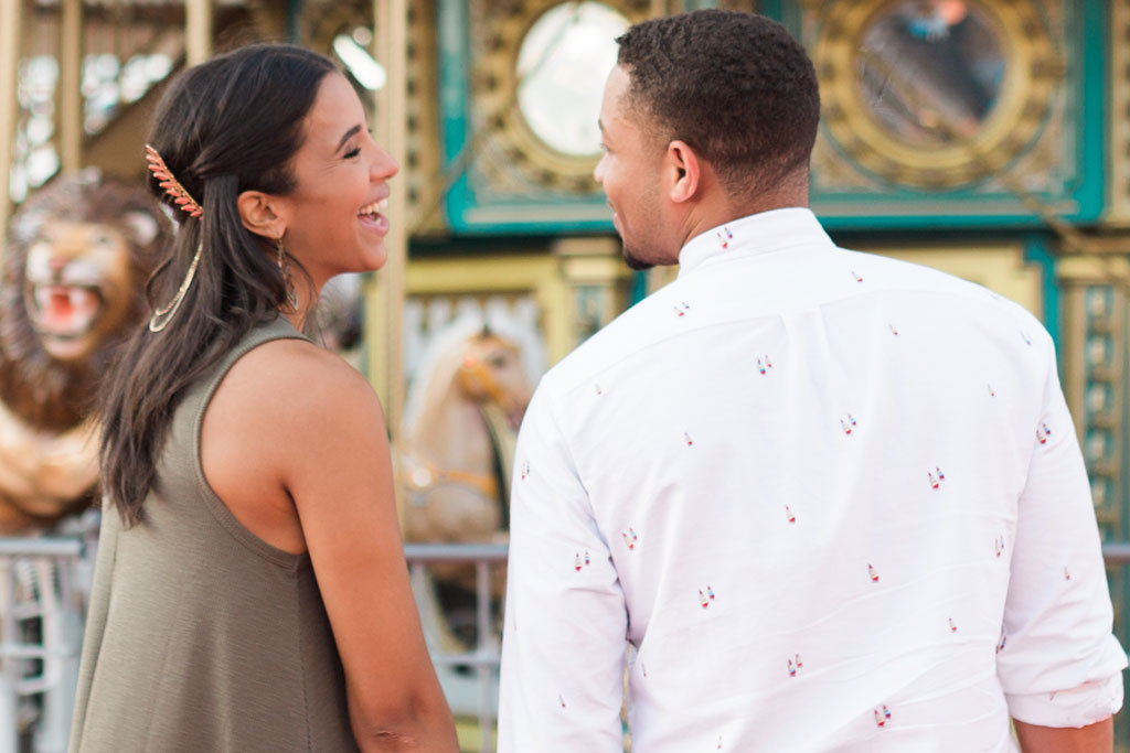 Couple Laughing While on Galveston Island Historic Pleasure Pier. Galveston, TX