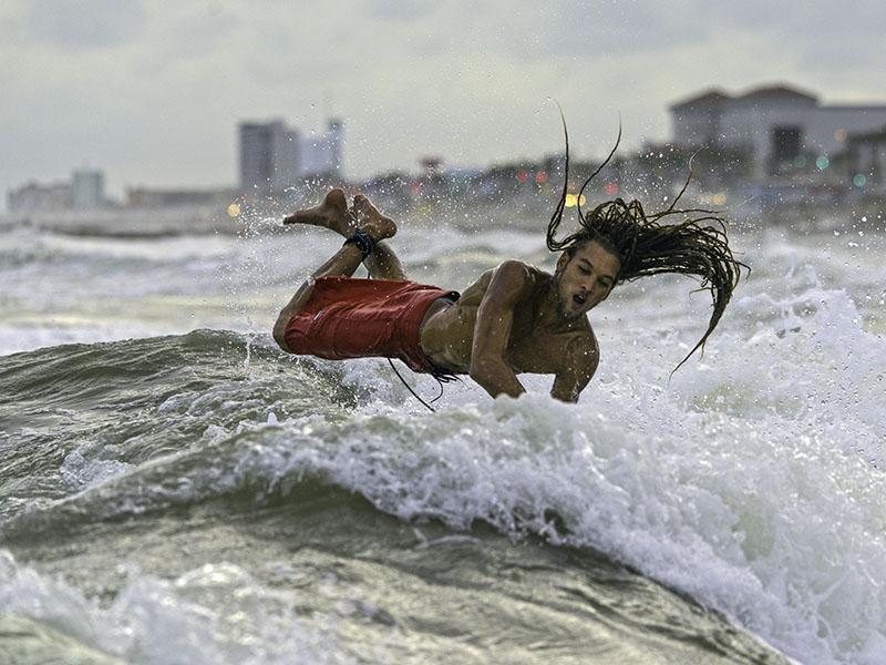 Surfer in Waves