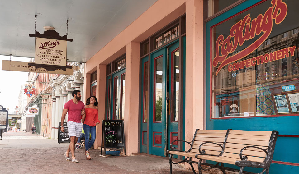 Couple Walking Into LaKing's Confectionery