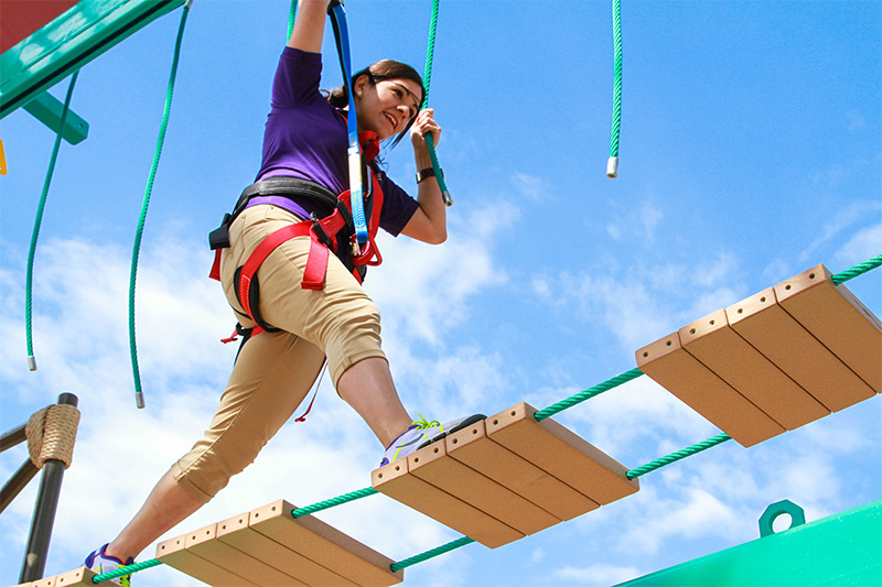 Girl on Ropes Course at Moody Gardens