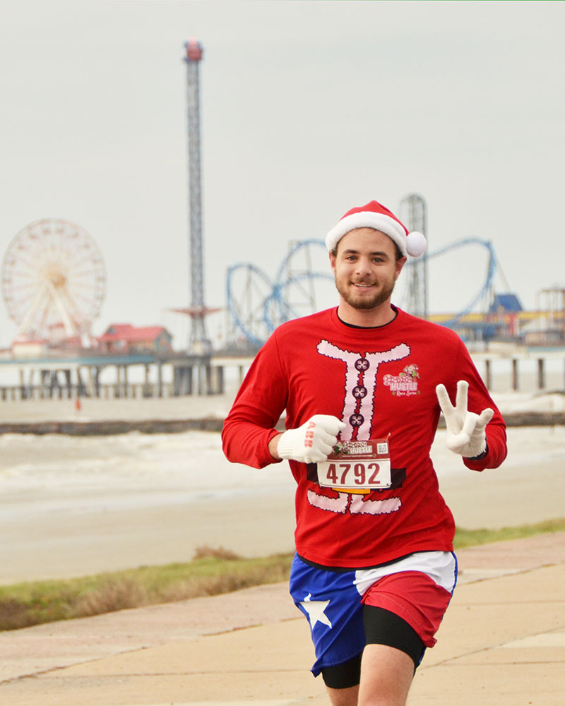 Guy Running in Santa Hustle Race