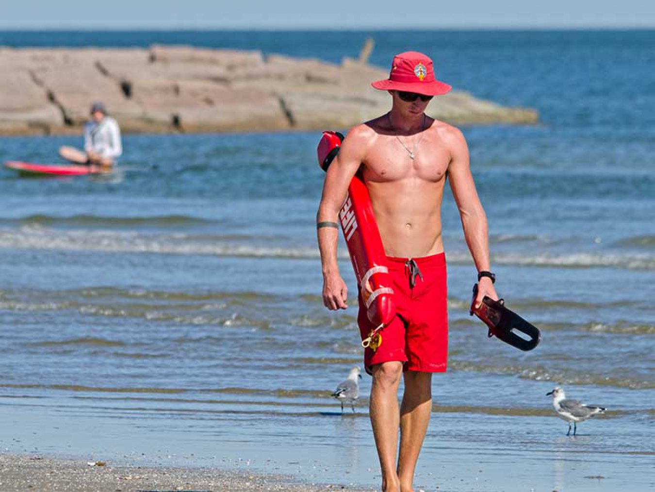 Lifeguard Beach Paddleboarder