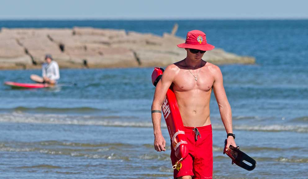 Lifeguard Beach Paddleboarder