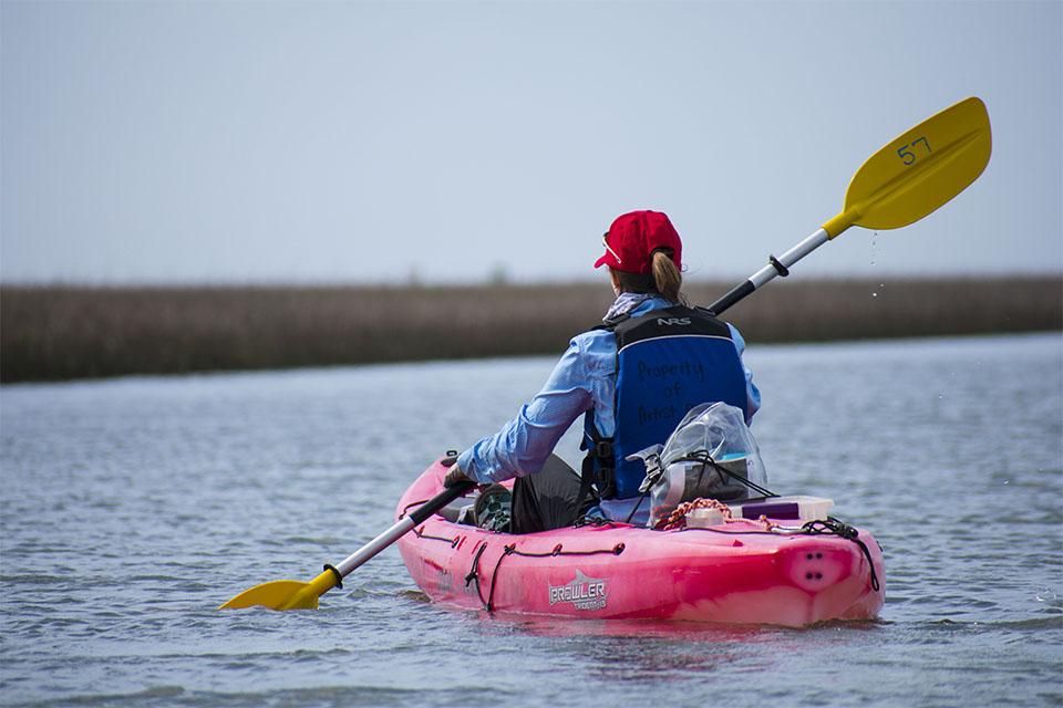 Woman Kayaking in East End Lagoon