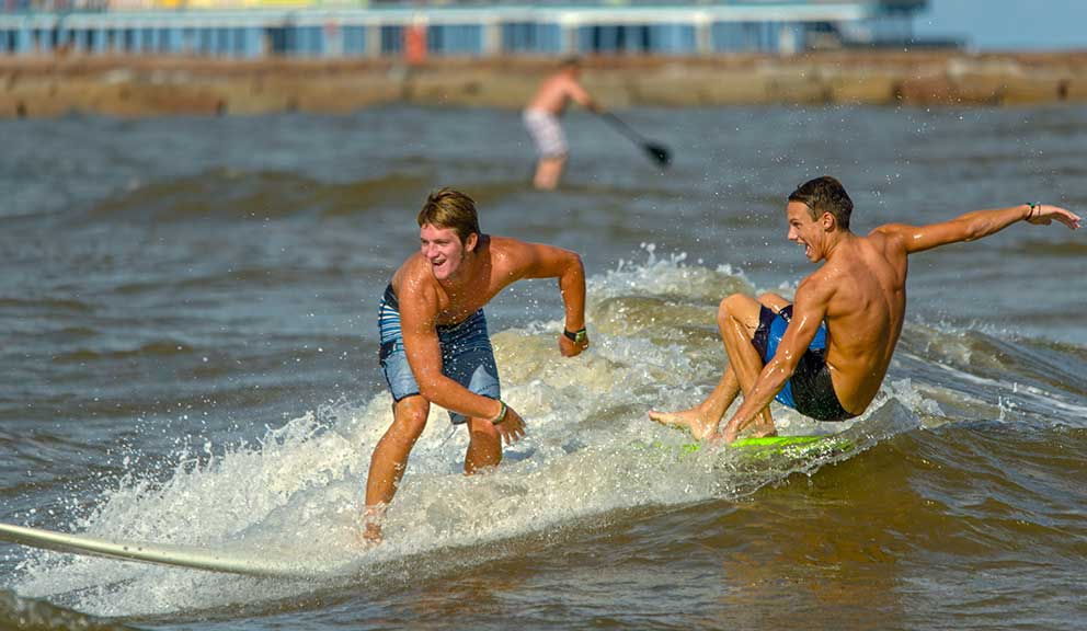 Boys Surfing at the Beach