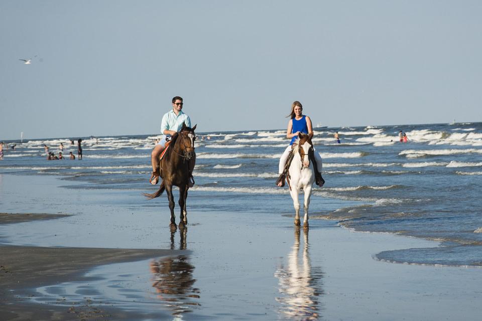 Couple Horseback Riding on Galveston Beach