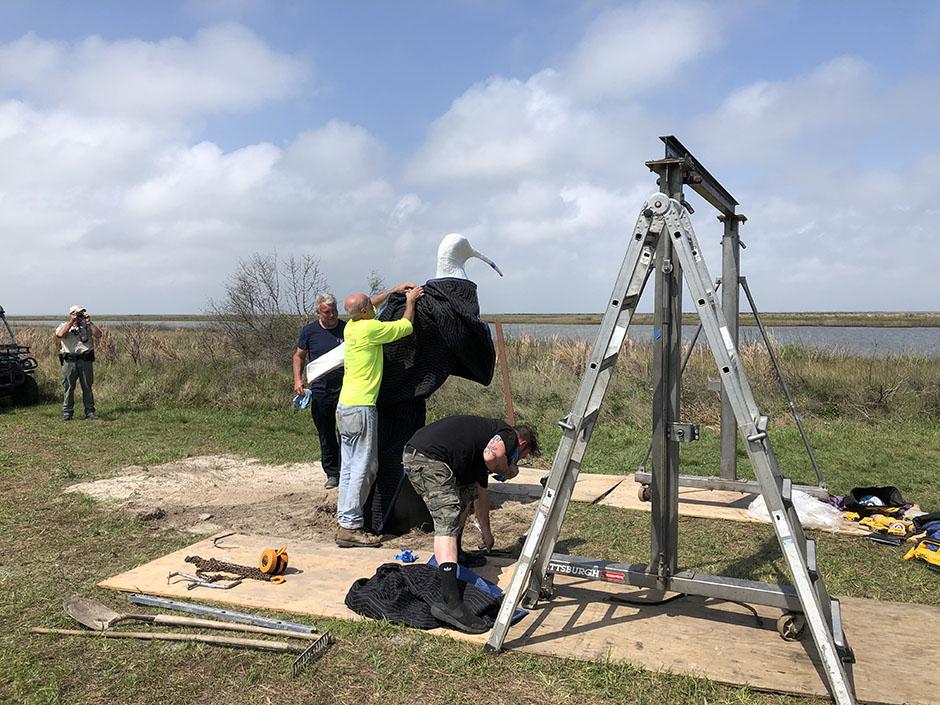 Crew Installing Sculpture