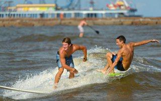 Surfers Near the Pleasure Pier